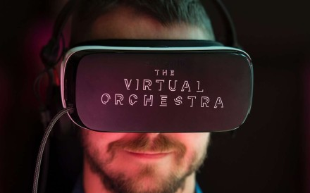 A visitor gets to see inside the orchestra via a virtual-reality headset at the Royal Festival Hall at London's Southbank Centre. Photo: AFP
