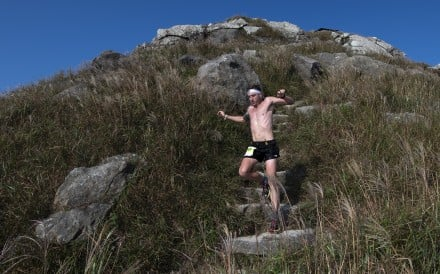 Vlad Ixel comes off Lantau Peak at the front of the pack. Photos: Action Asia