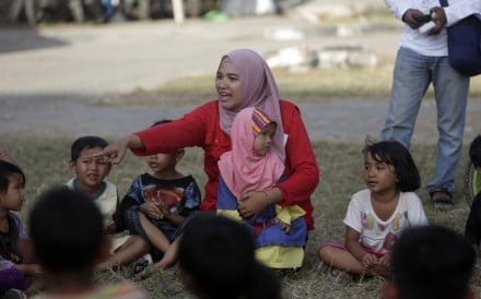 Group of displaced children play together as part of trauma healing session, an initiative provided by 'Save The Children' in Palu city. Many children went back to school on Monday, as schools tried to get an idea of how many would be returning to classrooms after the disaster. Photo: EPA