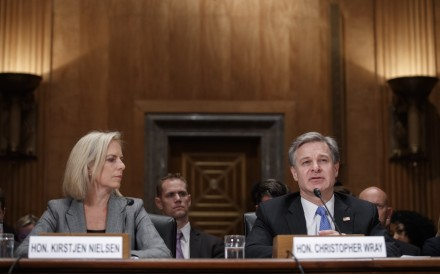 Secretary of Homeland Security Kirstjen Nielsen and FBI Director Christopher Wray testify during a Senate Homeland Security and Governmental Affairs Committee hearing on October 10, 2018. Photo: EPA