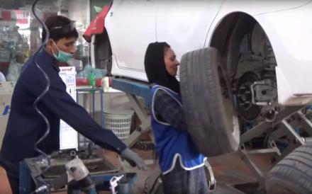 Uzma Nawaz, who has a mechanical engineering degree, at work at a Toyota dealership in Multan, Pakistan. Photo: AFP