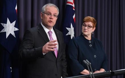 Australian Prime Minister Scott Morrison speaks to the media alongside Minister for Foreign Affairs Marise Payne. Photo: EPA