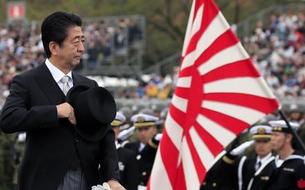 Japanese Prime Minister Shinzo Abe during a military parade. Photo: EPA