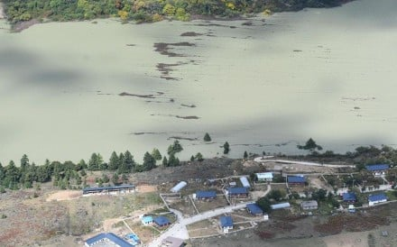 A village threatened by the landslide-caused barrier lake on the Yarlung Tsangpo River in Tibet on Thursday. Photo: Xinhua
