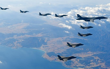 A US Air Force B-1B Lancer bomber (right top), flanked by US and South Korean fighter jets fly over South Korea during the 2017 Vigilant Ace joint military drill. Photo: Agence France-Presse