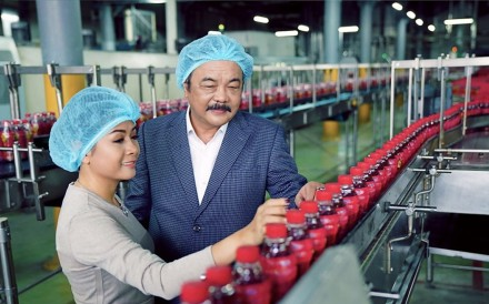 Tran Qui Thanh and daughter Phuong Uyen Tran at their Tan Hiep Phat Beverage Group factory in Vietnam. Photo: Tan Hiep Phat Beverage Group