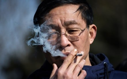 A man smokes a cigarette in Shanghai, one of the Chinese cities to have a smoking ban. Smoking-related illnesses kill more than a million people a year in China. Photo: AFP