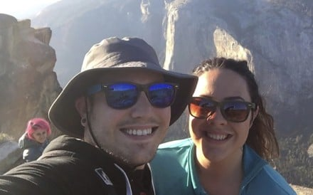 In this October 21, 2018 photo provided by Sean Matteson, Matteson poses for a selfie with his girlfriend Drea Rose Laguillo, at Taft Point in Yosemite National Park, California. Over Matteson's shoulder is Meenakshi Moorthy, who later fell to her death from the popular overlook. Photo: Sean Matteson via AP