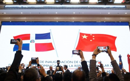 People take pictures during the opening ceremony of the Dominican Republic's embassy in Beijing. Photo: AFP