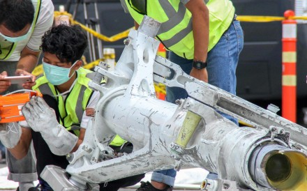 Lion Air investigators examine part of the landing gear of ill-fated Lion Air flight JT 610 in Jakarta on Monday. Photo: AFP