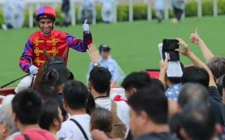 Joao Moreira celebrates a winner with the fans at Sha Tin. Photos: Kenneth Chan