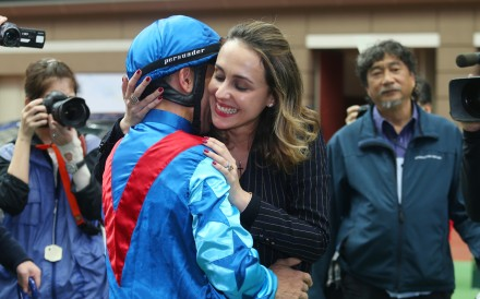 Joao Moreira hugs wife Taciana after winning the 2017 Hong Kong Derby. Photos: Kenneth Chan