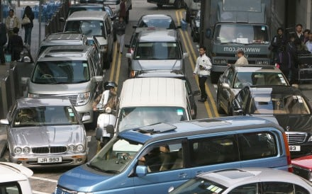 Cars parked in no-parking areas on both sides of Bank Street in Central cause traffic mayhem in 2007. Photo: SCMP