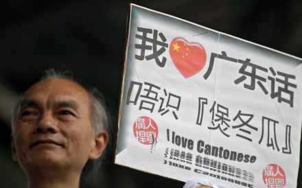 A man declares his love for Cantonese, and disdain for Mandarin, on a placard. Photo: AFP