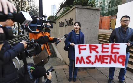 Supporters holding a sign at a Vancouver, British Columbia, courthouse prior to the bail hearing for Sabrina Meng Wanzhou, Huawei's chief financial officer, on Monday. Meng has been detained at the request of the US since December 1. Photo: The Canadian Press via AP)