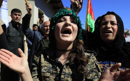 Syrian Kurds in the northeastern city of Qamishli protest against a Turkish assault on the Syrian border enclave of Afrin on March 11. Photo: AFP