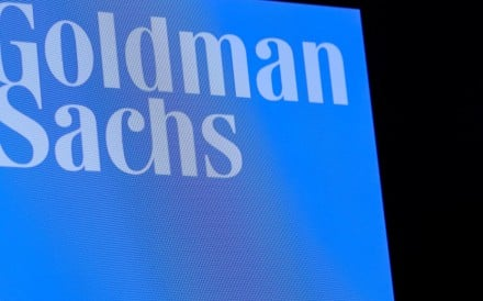 The ticker symbol and logo for Goldman Sachs is displayed on a screen on the floor at the New York Stock Exchange. Photo: Reuters