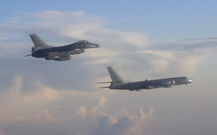 A Taiwanese F-16 fighter jet shadows a PLA H-6 bomber over the Bashi Channel south of Taiwan. Photo: Military News Agency