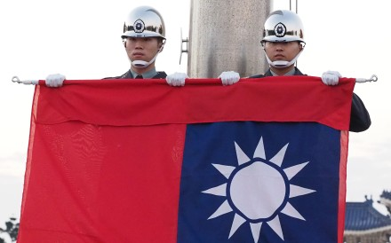 Soldiers perform a flag-lowering ceremony at Liberty Square in Taipei. Photo: EPA-EFE