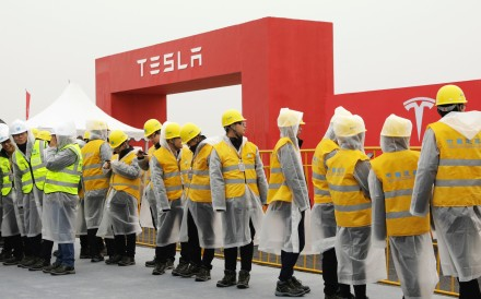 Workers at the site of the Tesla manufacturing facility in Shanghai. The US carmaker broke ground on its planned US$5 billion factory on January 7, 2019. Photo: Bloomberg