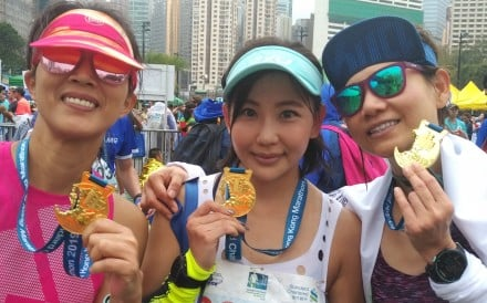 Amy Yan, Jackie Wong and Jessica So after finishing the Hong Kong Marathon. The three train together and are also friends. Photo: Patrick Blennerhassett