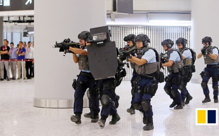 More than 300 armed police officers mounted the first large anti-terrorism drill in the West Kowloon terminus of the Guangzhou-Shenzhen-Hong Kong Express Rail Link, ahead of its opening in...