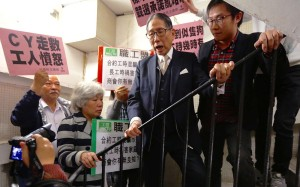 Protesters demanded to speak to Standard Working Hours Committee chairman Dr Leong Che-hung (centre). Photo: Nora Tam