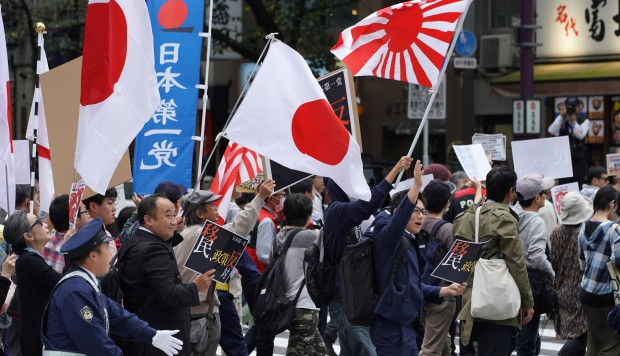 Abe's plan to admit foreign workers draws 'Japan First' backlash