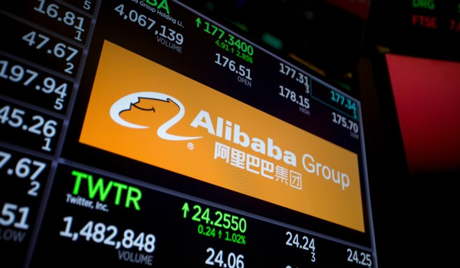 A monitor displays Alibaba Group signage on the floor of the New York Stock Exchange.
