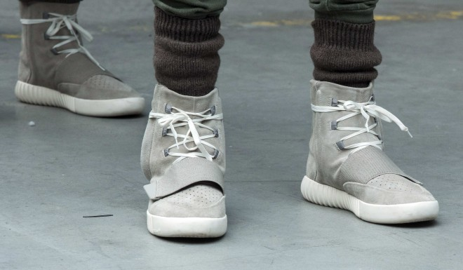 A model wears a pair of Adidas Yeezy 750 Boost shoes designed by Kanye West in 2015.