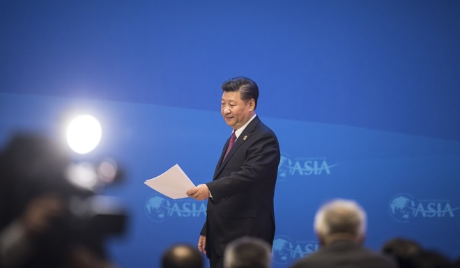 Xi Jinping walks off the stage after completing his keynote speech.