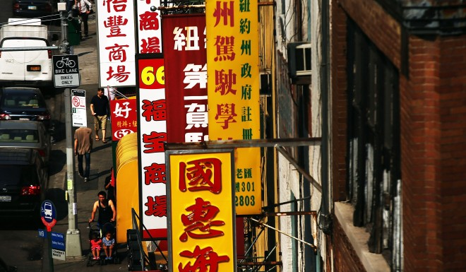 Shop signs written in traditional characters can be found in the Chinatown in New York City.