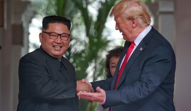 Kim cracked a smile after photos were taken.