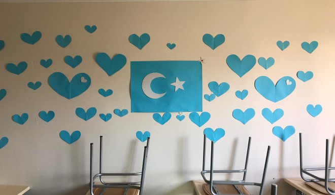 A paper cut-out of the Uyghur national flag on the wall at the Uygur Ilim Marifet Vakfi in Istanbul.