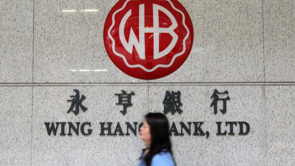 Local lender Wing Hang will de-list when the deal with Singapore's  Oversea-Chinese