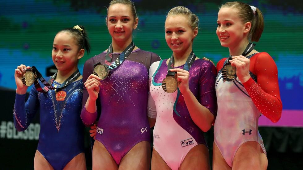 From left) China's Fan Yilin, Russians Viktoria Komova and Daria ...