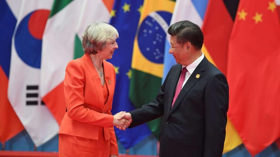 Image result for Theresa May pledges to raise Hong Kong and human rights with China