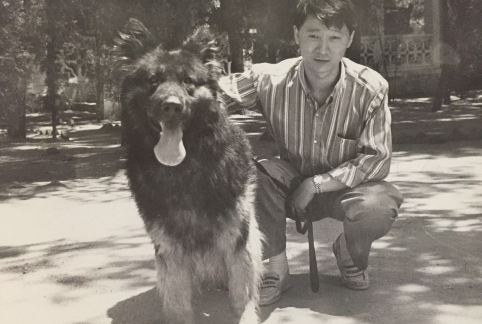 Ma Baoli poses with a dog when he was a young police cadet in the early 1990s.