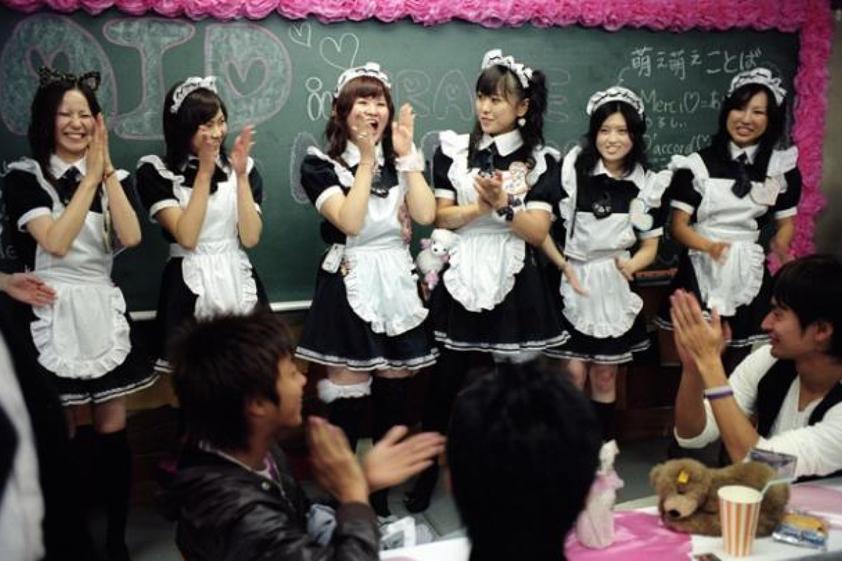 Waitresses in a French maid-themed cafe in the city. Photos: Marianne Lacey; Corbis