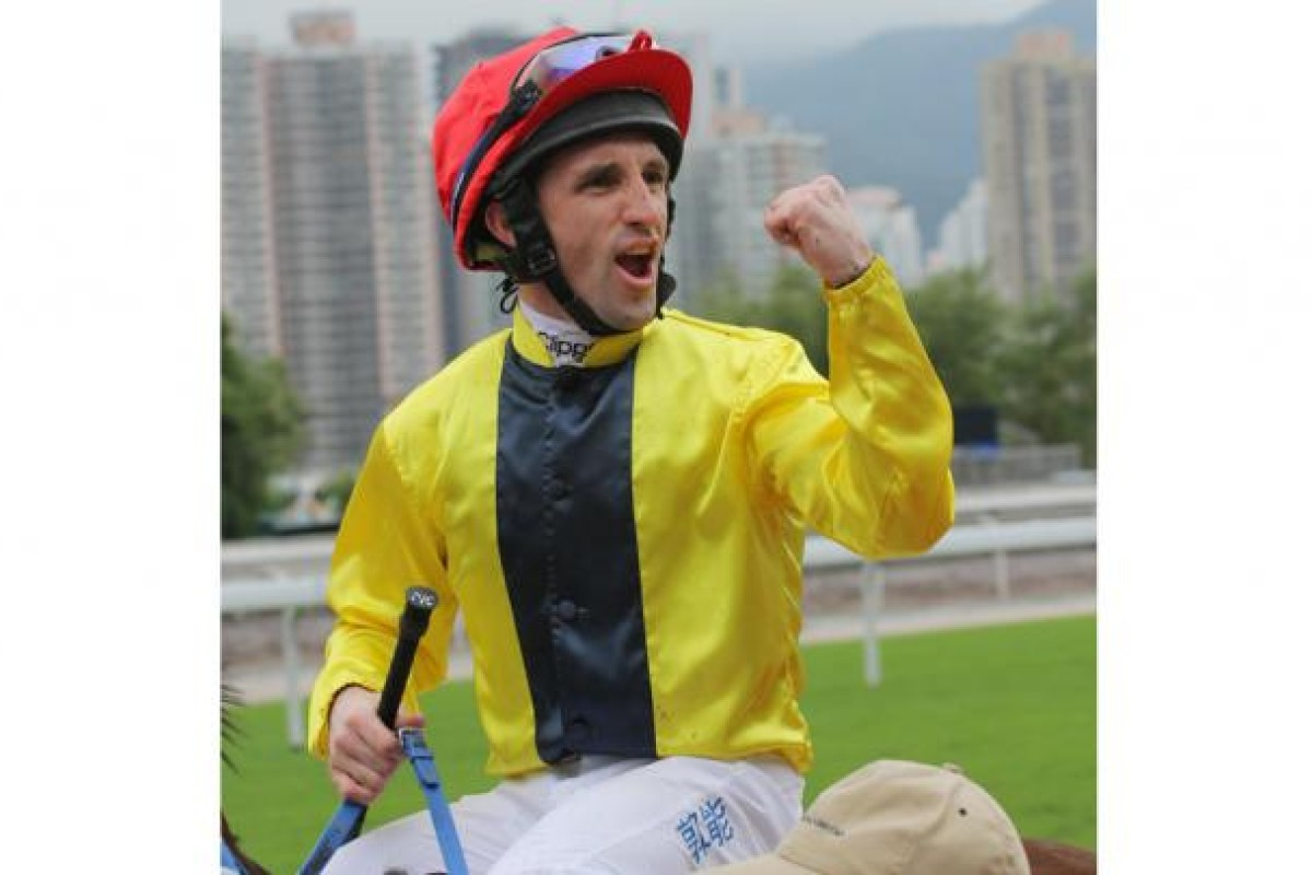 Neil Callan pumps his fist after winning on Chater D'Cat.