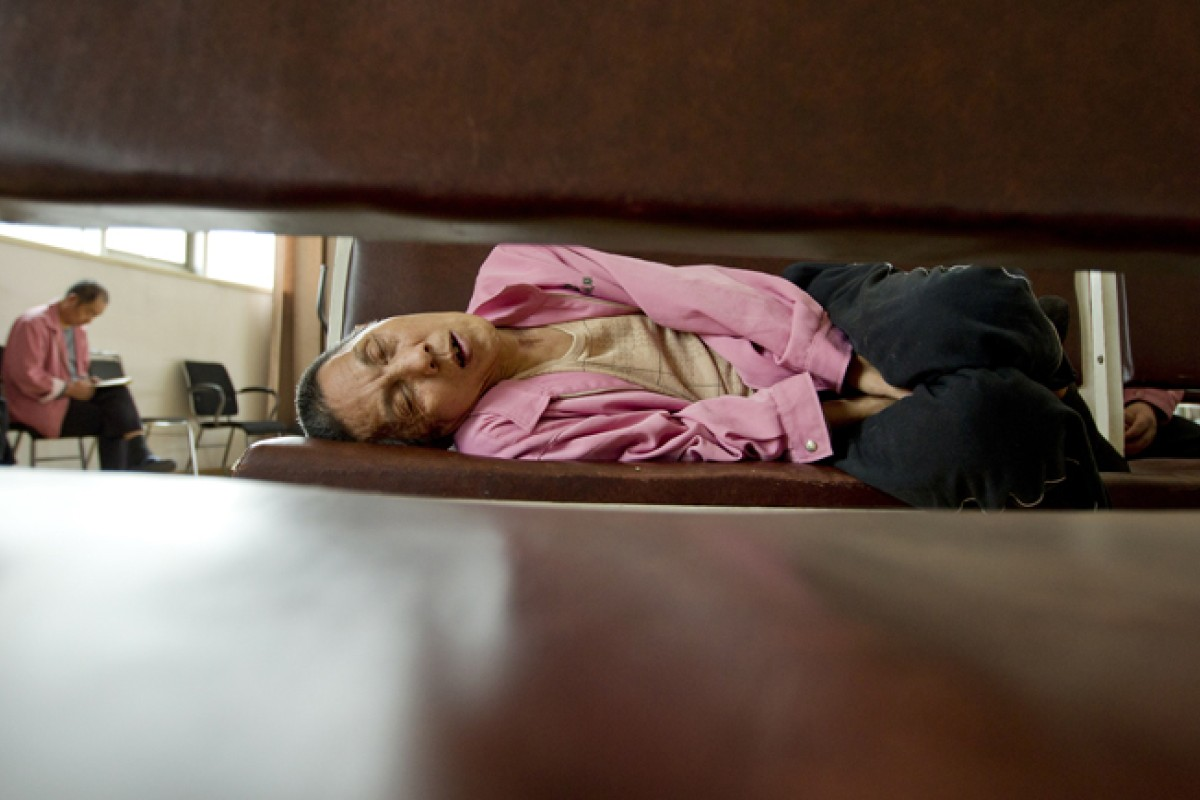 A patient naps at the Jiamusi Psychiatric Hospital's Educated Youth (zhiqing) Division.