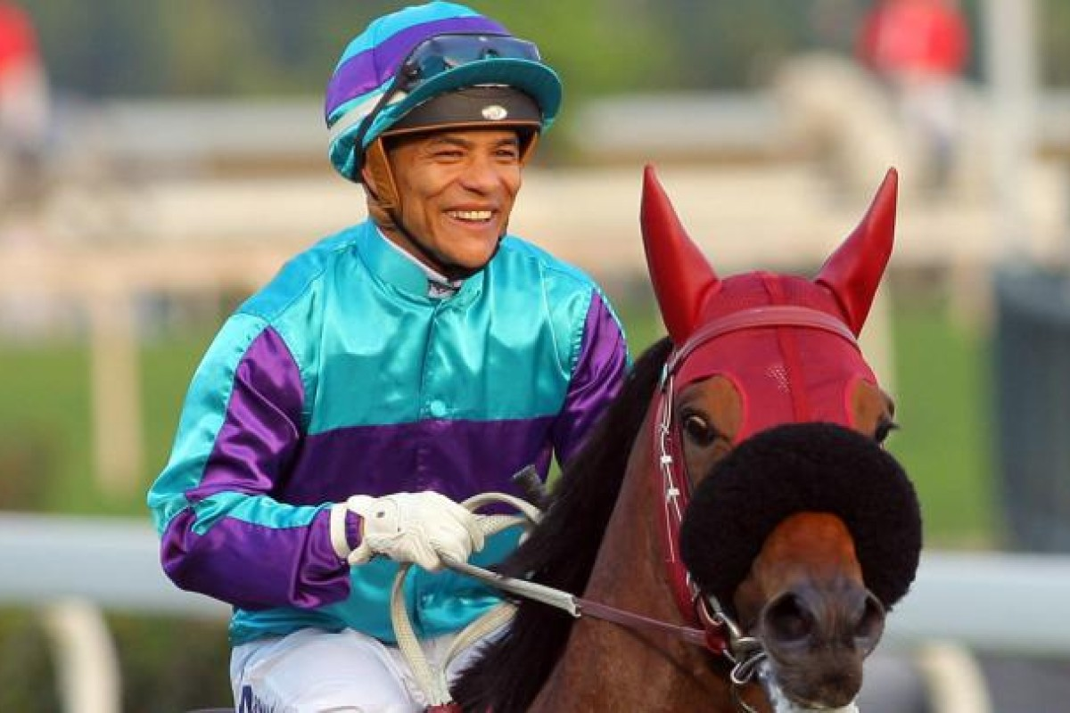 Weichong Marwing smiles after winning race nine on Same World. Photo: Kenneth Chan