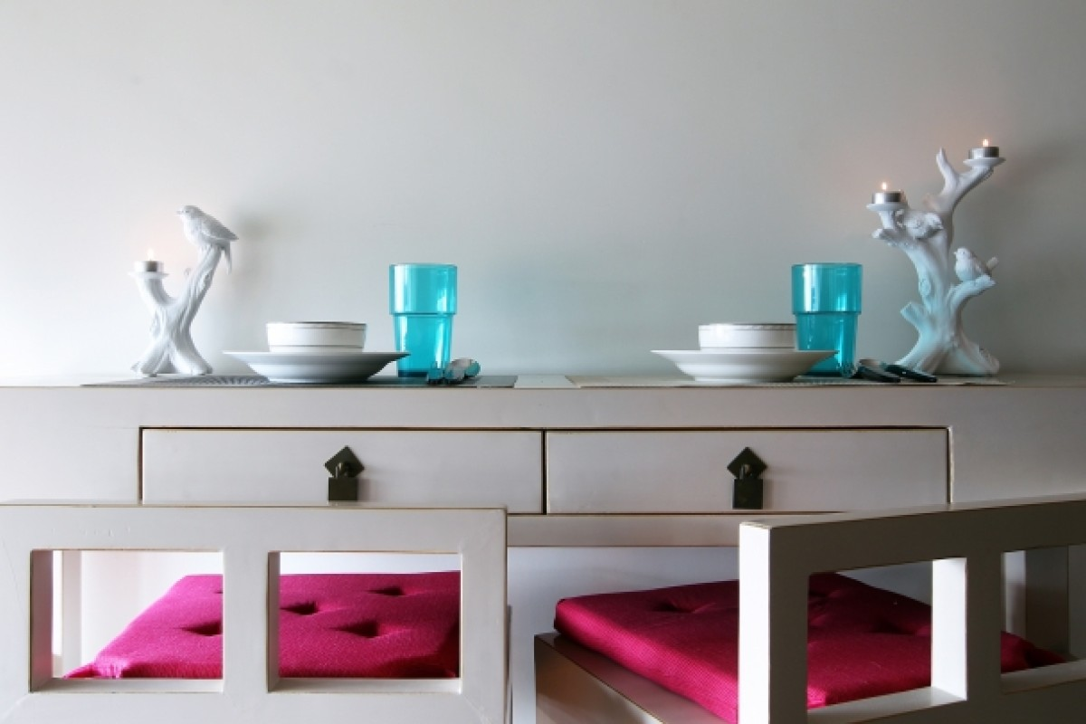 Dining area: Yeung-Salansy created a small dining area in the narrow kitchen by designing an extra-slim bar table and high stools that fit neatly underneath. The table (HK$5,500) and stools (HK$1,400 each) were made by Zhonghua Rui Antiques. The Vaken glasses (HK$39.90 for a set of four) and pink seat cushions (HK$49.90 each) were from Ikea (various locations; www.ikea.com.hk). The bird candelabras were from Francfranc (various locations; www.francfranc.com.hk) and cost HK$300 each.