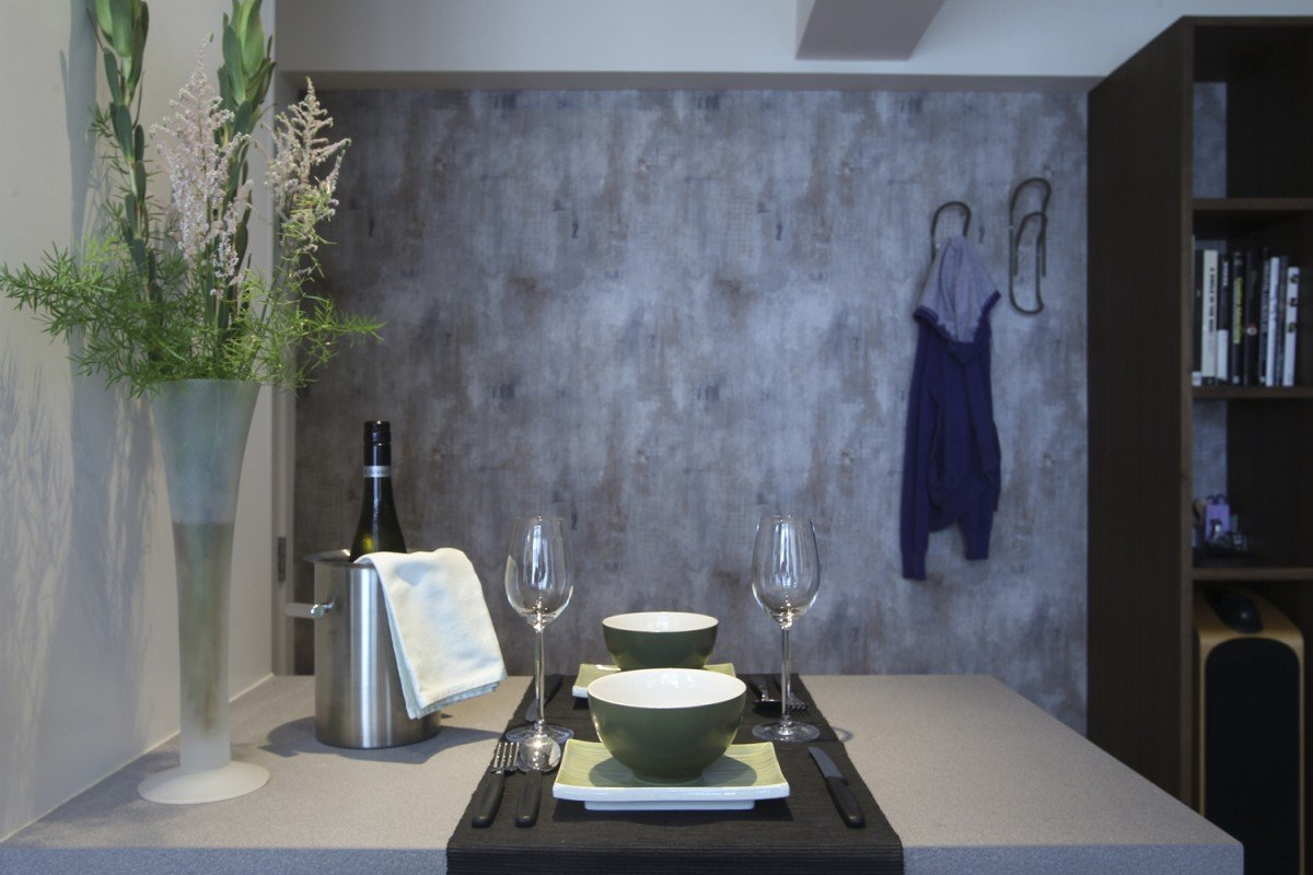 Dining area: The ''concrete'' wallpaper, by Carl Robinson, cost HK$780 a roll at Goodrich (2/F, Beverly House, 93 Lockhart Road, Wan Chai, tel: 2668 5757).