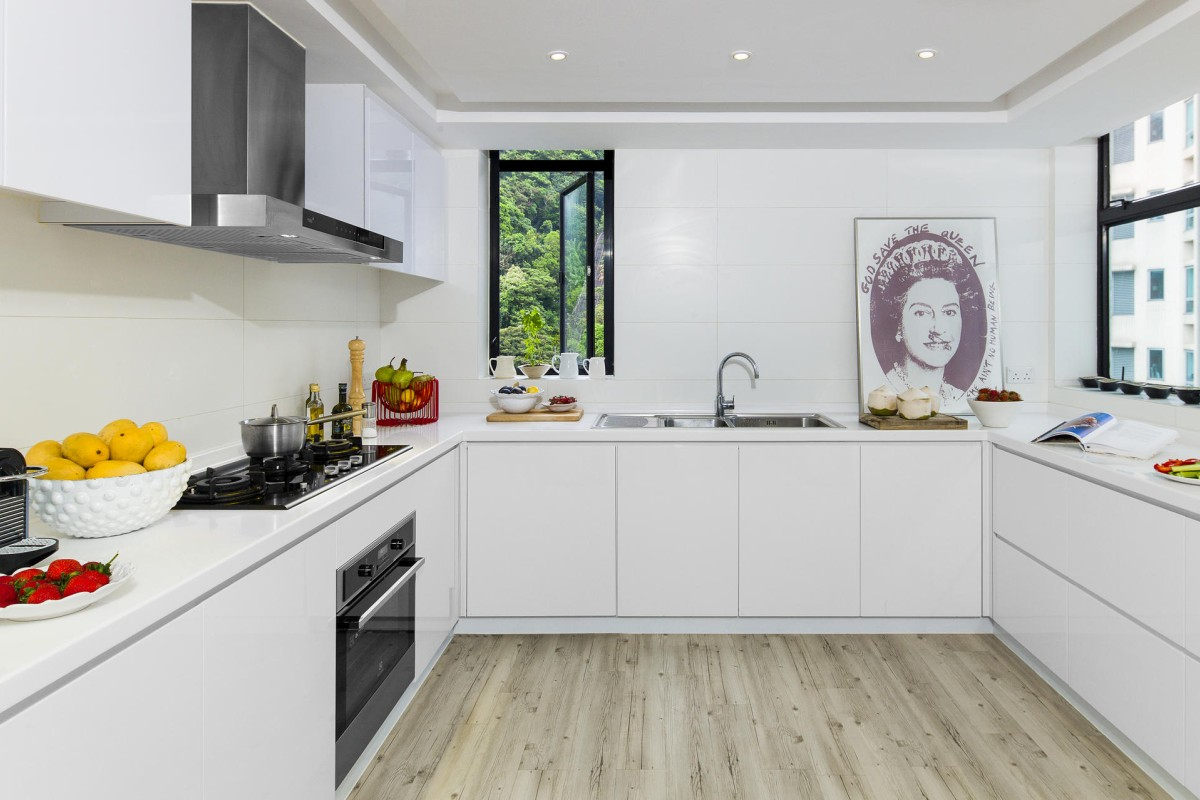 Kitchen: Dale covered the tiled floor in the kitchen with wood-look linoleum from Forever Wallpaper and Carpet (260 Lockhart Road, Wan Chai, tel: 2519 0178) at a cost of HK$20 a square foot (excluding installation). The God Save the Queen poster was by English artist Jamie Reid (www.jamiereid.org).