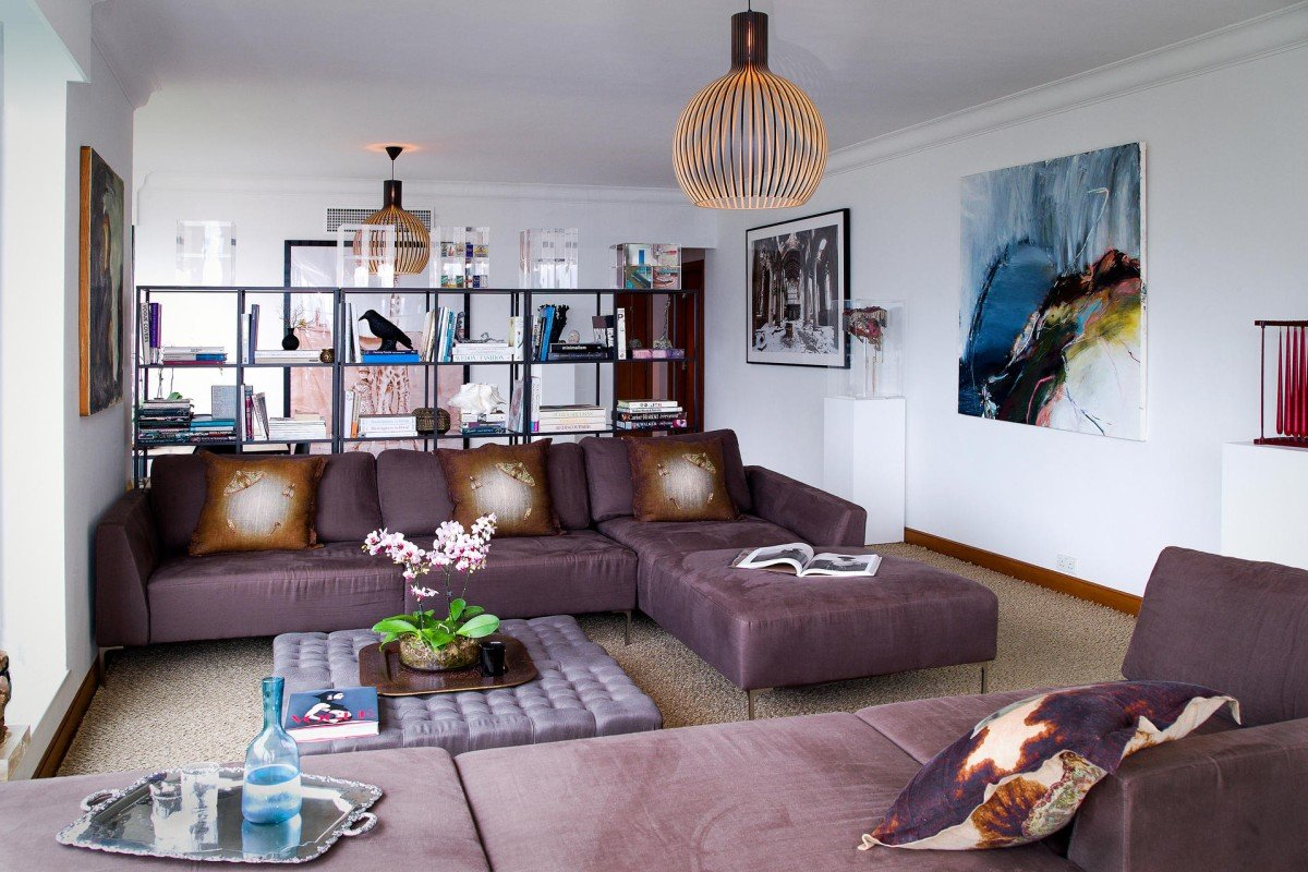 Living room: The sofas were made by Artura Ficus (various locations; www.arturaficus.com) years ago. The ottoman was created with two bed-end stools from a store in Ap Lei Chau that has now closed. The cushions, by Timorous Beasties, were £145 (HK$1,720) each at Liberty in London (www.liberty.co.uk). The silver-plated tray (HK$3,000) is sold through Oenone Dale's company, Oenone Ware (tel: 9669 4254; www. oenoneware.com). The red candle sculpture came from a shop called Le Magasin, in Britain (50a Cliffe High Street, Lewes, East Sussex, tel: 44 1273 474 720). The abstract painting next to it was a birthday present. The Church photograph, by Denice Hough, came from The Cat Street Gallery (222 Hollywood Road, Sheung Wan, tel: 2291 0006). The shelving was from Ikea (various locations; www.ikea.com.hk). The Seppo Koho ceiling lights (HK$8,500 each), by Secto Design, came from Homeless (29 Gough Street, Central, tel: 2581 1880).