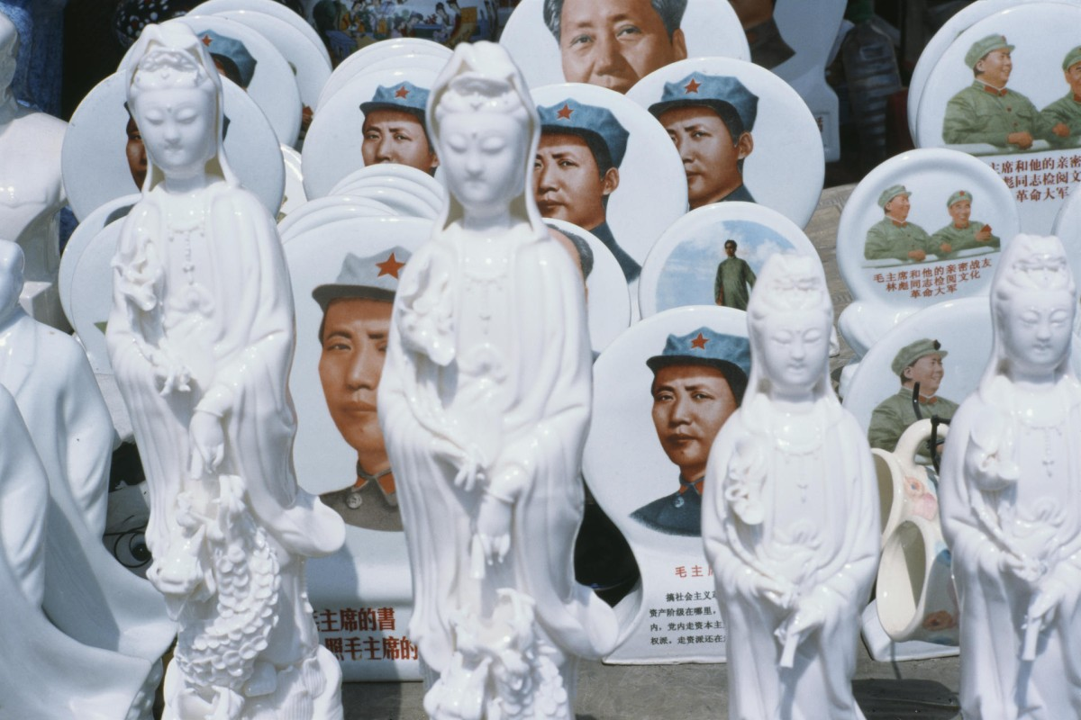 A store in the town displays ornaments featuring Mao Zedong and figurines of Guanyin, the Buddhist goddess of mercy.