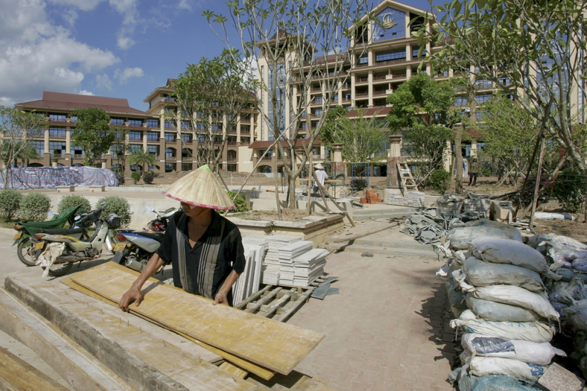 A Vietnamese worker at the site of a Chinese-built hotel in Vientiane.