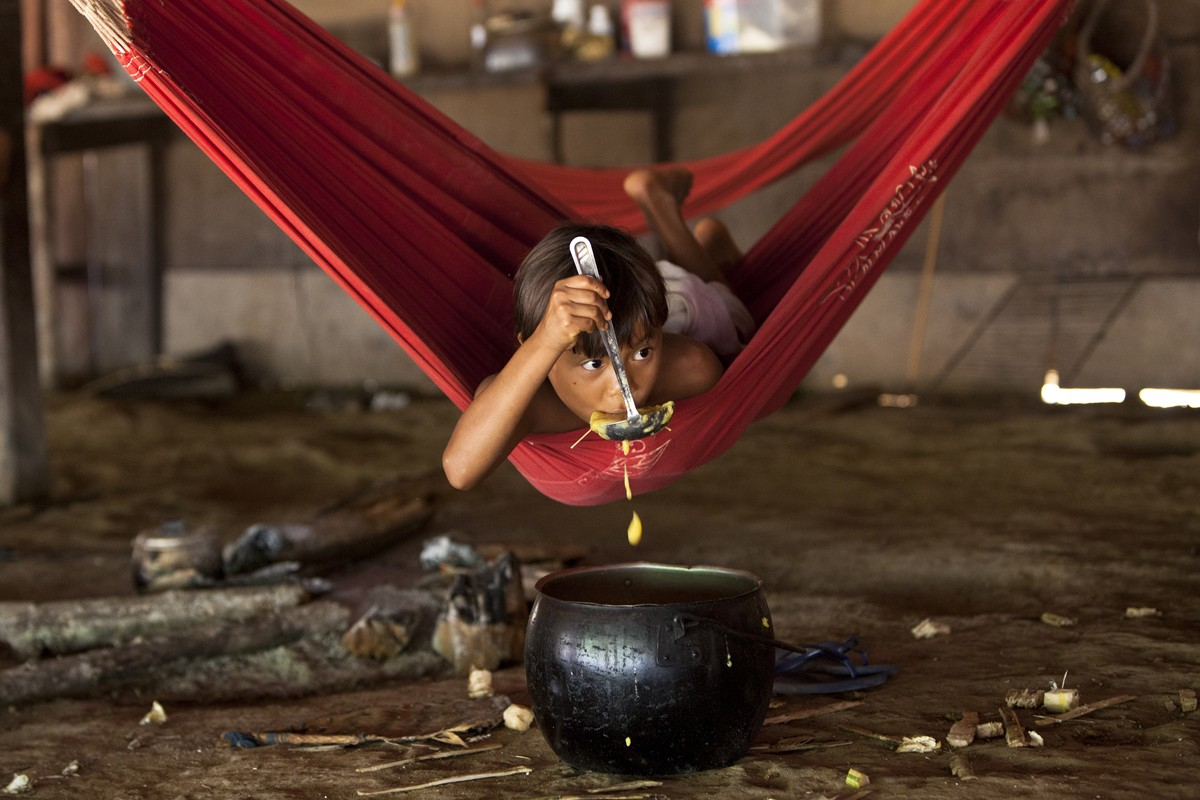 A young Yanomami girl eats manioc soup, during the making of Brazil with Michael Palin, last year.