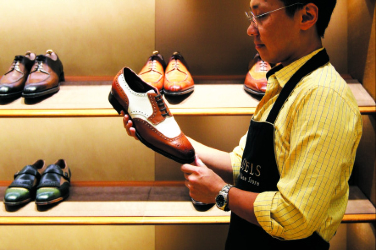 Victor Kwan, co-owner of Tassels, says customers do not mind the long wait.